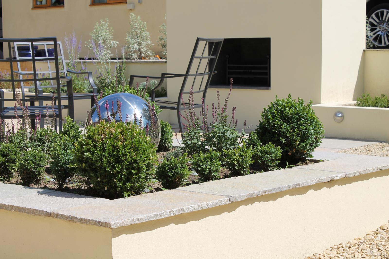 Sunken courtyard garden outerspace for Outer space garden design clevedon