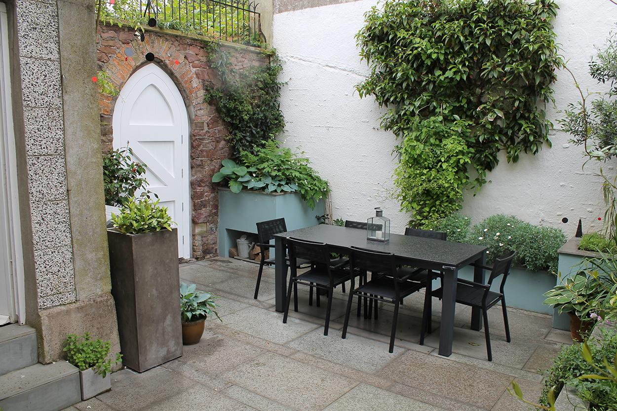 Clifton courtyard outerspace for Outer space garden design cumbria