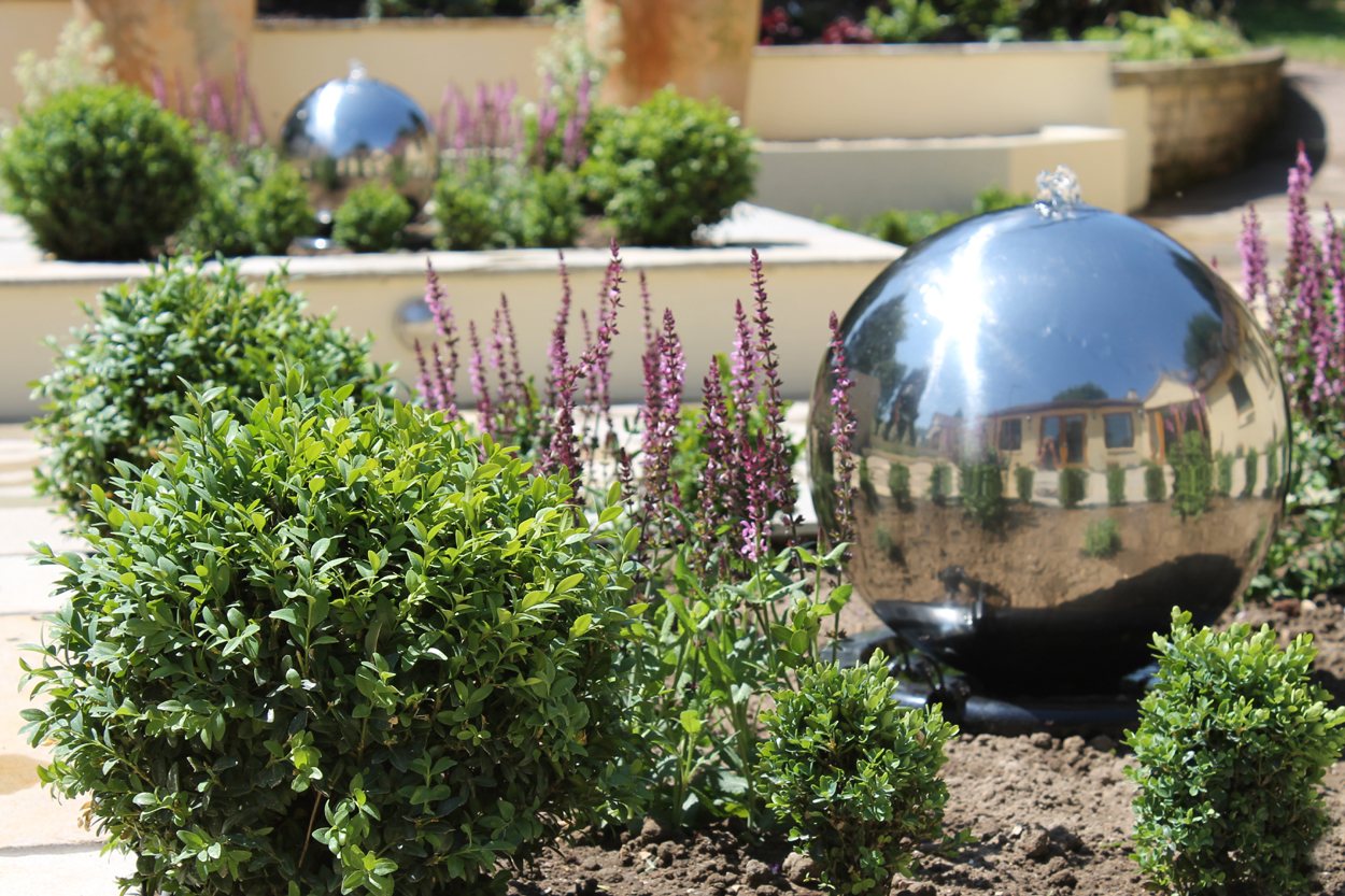 Sunken courtyard garden outerspace for Outer space garden design cumbria