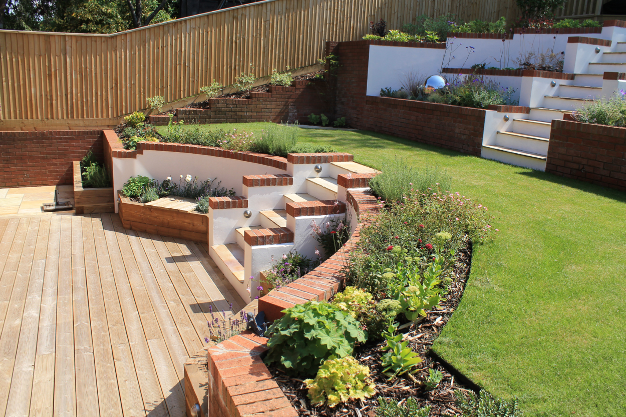 Garden on dramatic levels outerspace for Outer space garden design clevedon